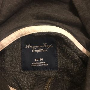 Slate grey American Eagle hooded zip up sweater.